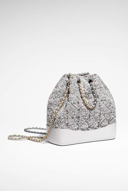 fa46ce8ed7c4db CHANEL's GABRIELLE backpack, tweed, calfskin, silver-tone & gold-tone  metal-gray & pink - CHANEL