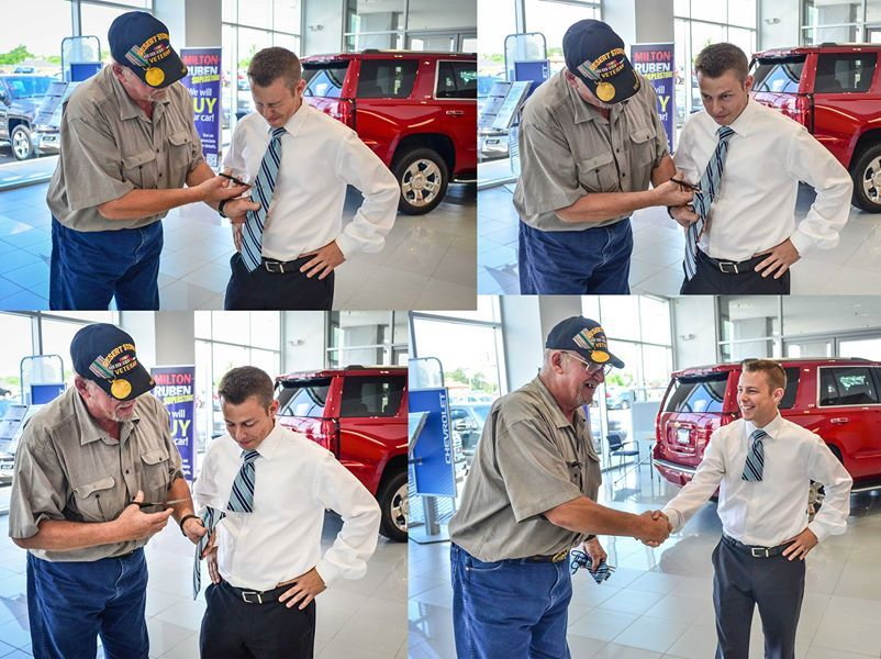 """Our new salesman, Brandon Wind celebrated selling his first car by participating in a time honored tradition, the """" cutting of the tie """" with his customer Jesse Parrish. Jesse is the proud owner of 2014 Chevrolet Silverado! http://www.miltonrubenchevy.com/ #chevrolet #tradition"""