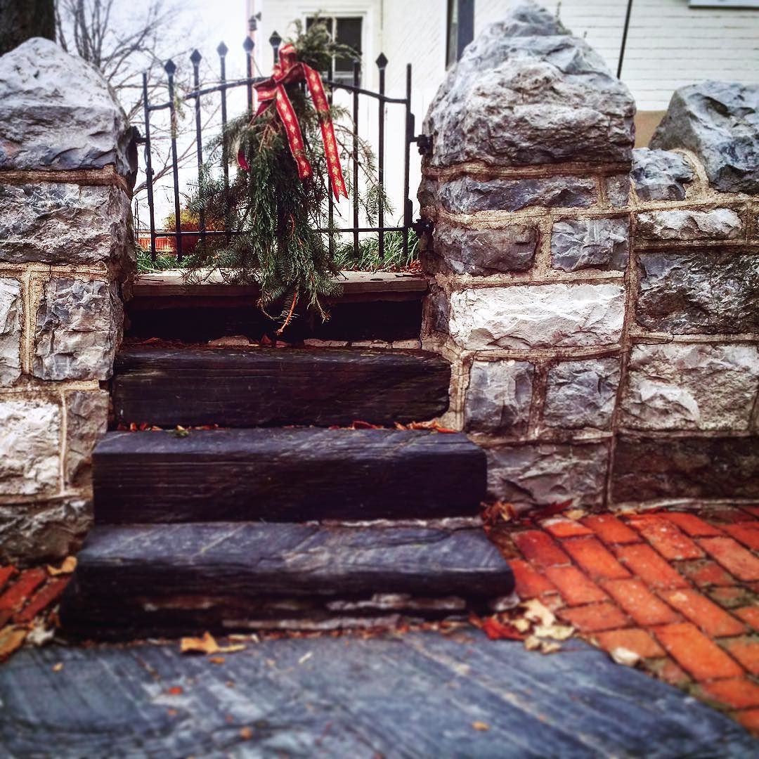 Festive slate steps. #steps #stairs #slate #brick #walkway #wall #stone #stonewall #iron #gate #christmas #xmas #greens #ribbon #christmascity #december #bethlehem #historic #history #pennsylvania #pa