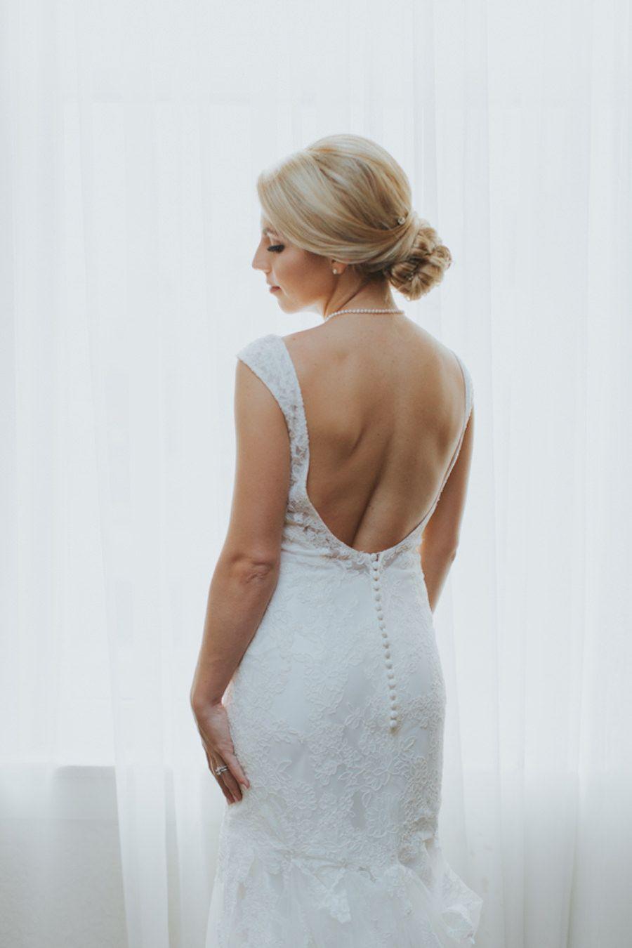 Lace wedding dress low back  Bride Wedding Portrait in Low Back Lace Ivory Allure Wedding