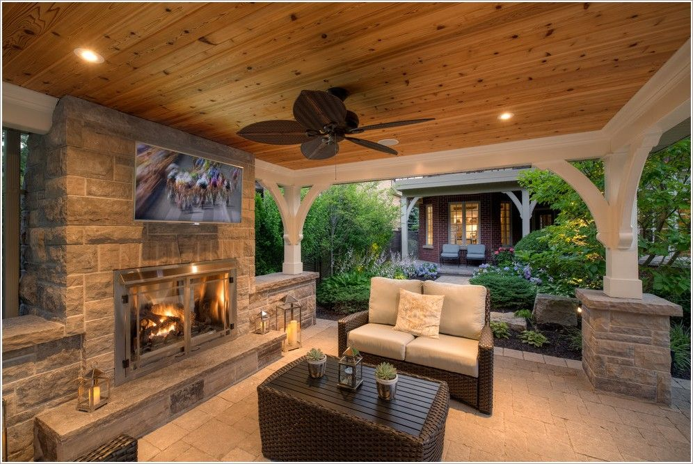 outdoor covered patio with fireplace and kitchen Outdoor Stone Fireplaces   lanterns outdoor TV pavilion