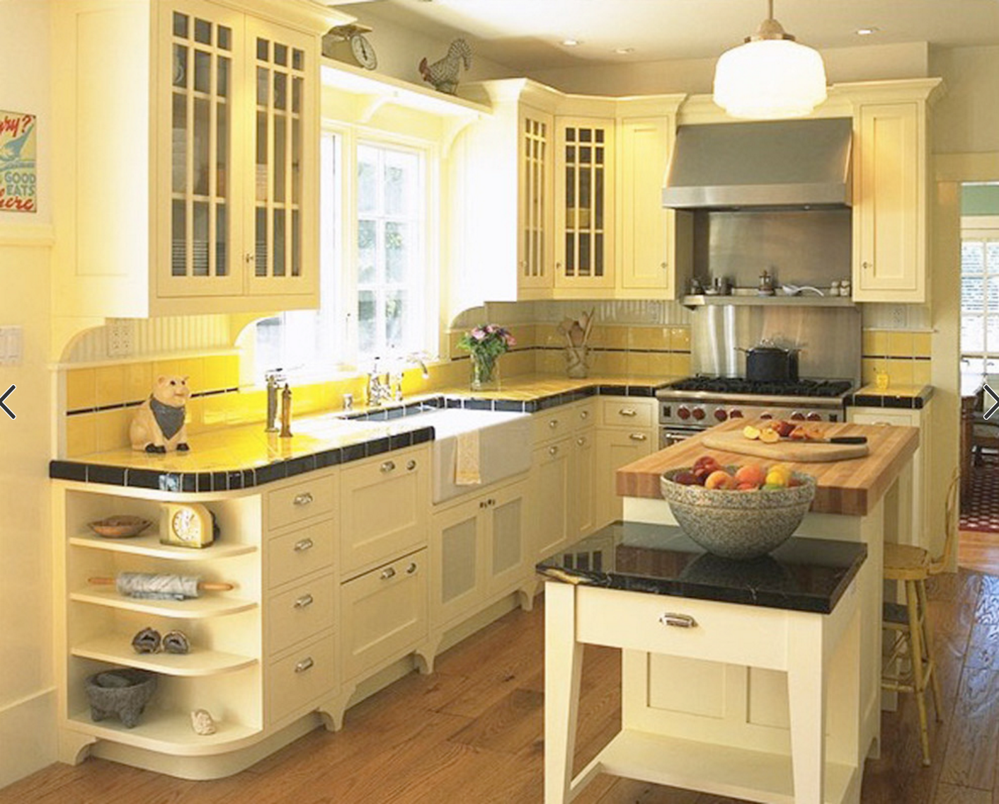 baking island, open shelving on end of cabinets, feet on ...