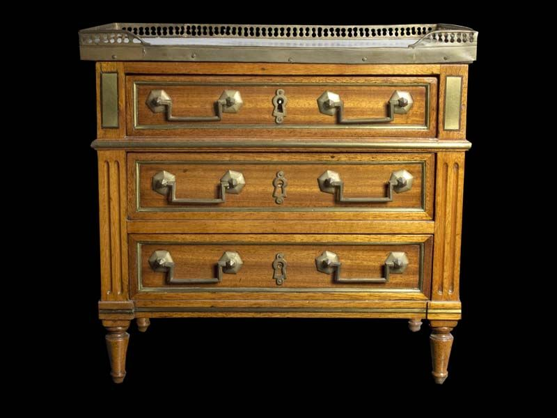Louis XVI style miniature chest of drawers, the rectangular marble top with pierced bronze gallery surmounting three bronze mounted drawers flanked by reeded pilasters and turned square tapered feet.