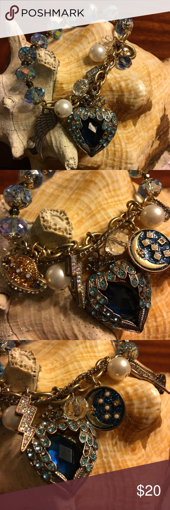 Betsey Johnson Blue Heart and Wings Bracelet Gorgeous charm bracelet by Betsey Johnson. Gold bracelet with blue beads, lightening bolt, moon, stars, wing and pearl charms. Listed matching necklace Betsey Johnson Jewelry Bracelets