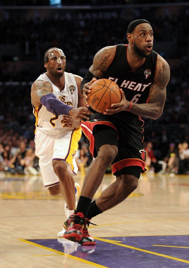 Lebron James 6 Of The Miami Heat Drives To The Basket Past Kobe Bryant 24 Of The Los Angeles Lakers During A 93 83 Laker Win At Staples Center On March 4 201
