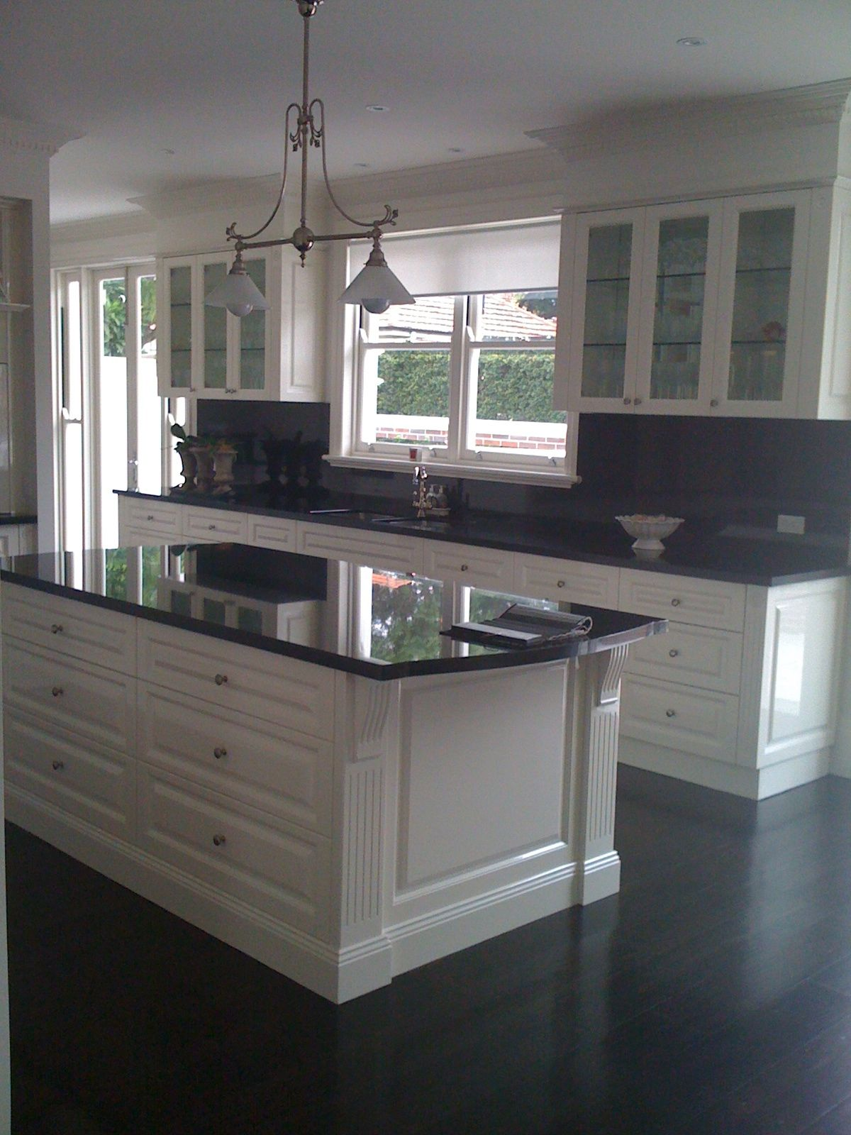 Indah island white with black granite benchtops