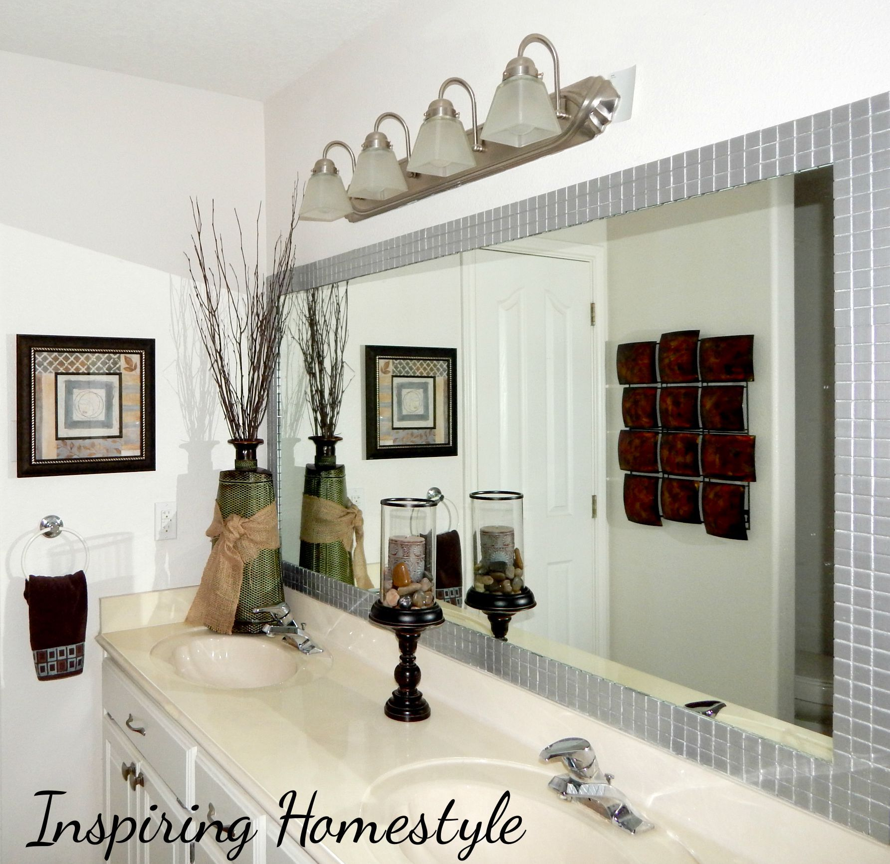 many of us have that same issue…a HUGE builder grade bathroom mirror ...