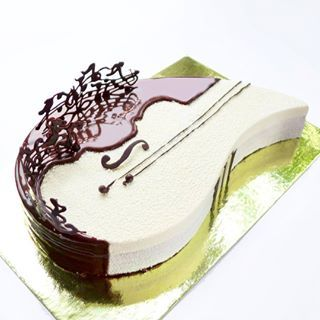 This intricate combination of strings and music notes Cake