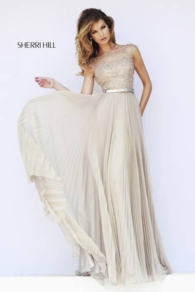 SHERRI HILL Prom Dresses 2015  # 32131 Bateau neck, cap sleeves and low back all covered with sequin beaded detailing are cinched with a complimenting metallic belt above the full length chiffon pleated skirt.