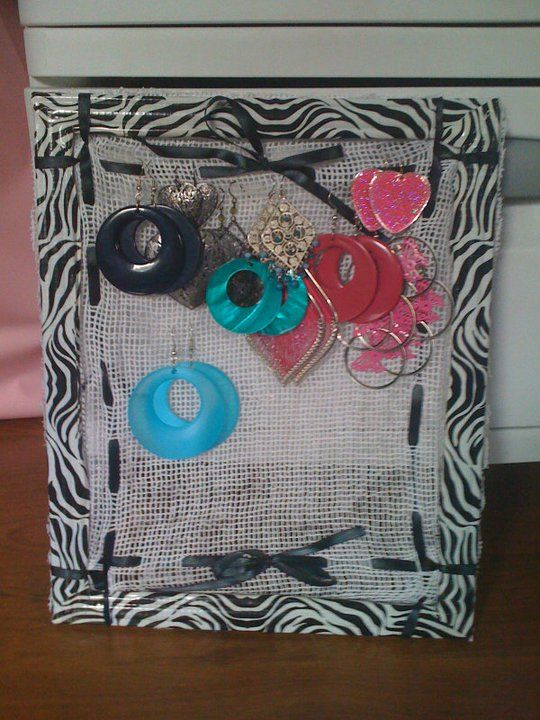 Earring holder I made with repurposed pic frame.  Made with deco tape, ribbon and an old scarf soaked in elmers glue.  Super functional!!