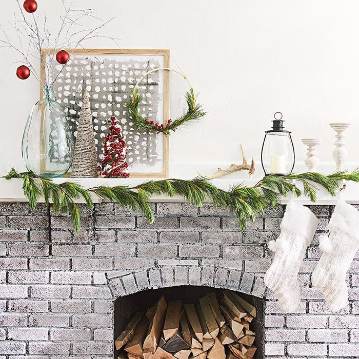 Christmas fireplace with ornament-adorned branches, mini Christmas - christmas fireplace decor
