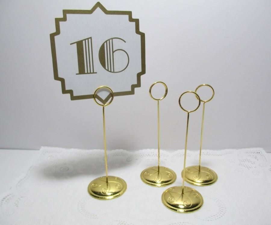 gold ring style table number stand, card holder. gold wedding table
