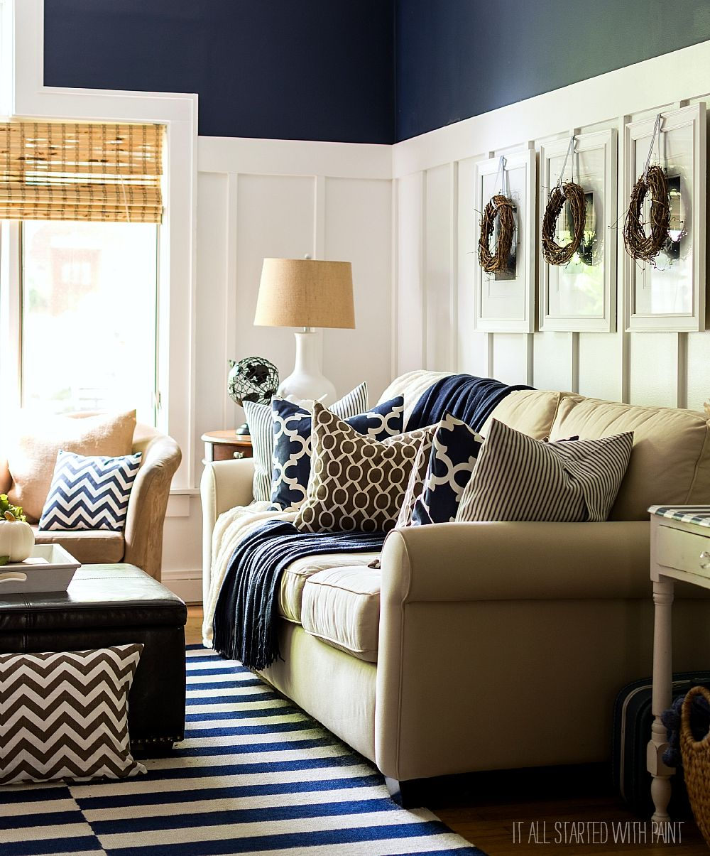 Fall decorating ideas using brown and navy neutrals board and batten living room decorated for fall