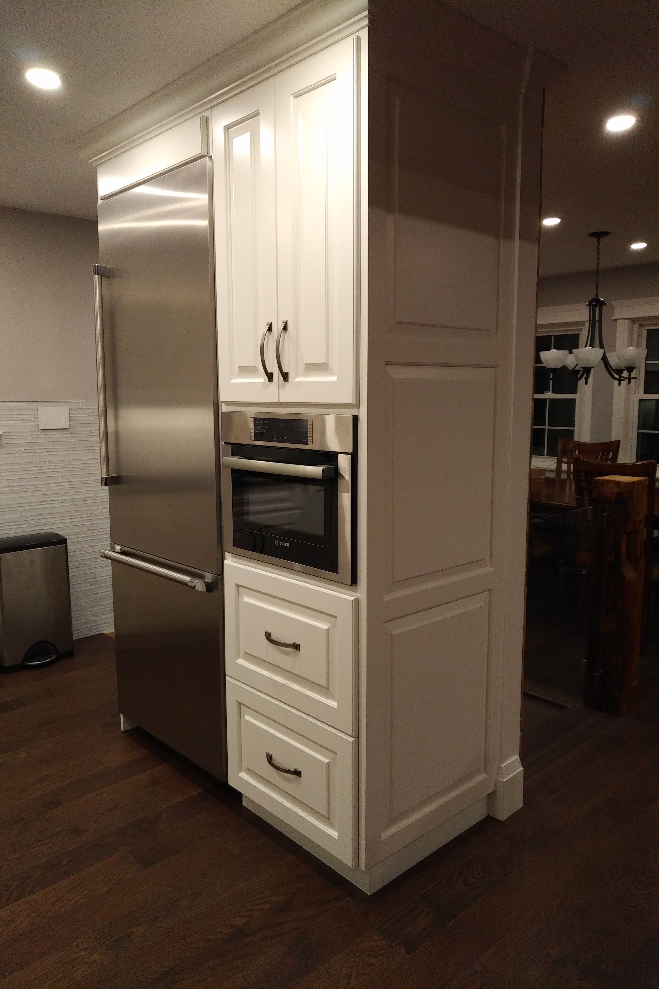 Wrap Around Wall Cabinet Design The Wall Was Left To Incorporate The Fridge And A Speed Oven This Freed Up Cabinet Design Kitchen Renovation White Backsplash