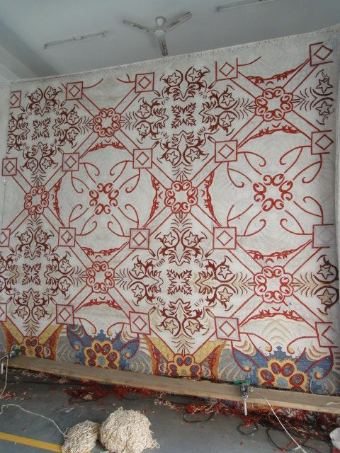 A beautiful traditional design starting to be hand-tufted.. what a process!!