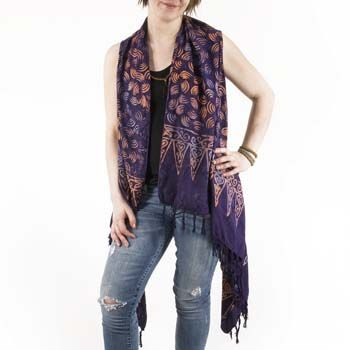 This lightweight long batik vest is inspired by our floaty batik sarongs. With tassels down the front edges for extra gypsy flair, this unique bohemian vest is made of comfy 100% rayon. Perfection paired with jeans, over one of our boho tops, or with a flowing hippie skirt!