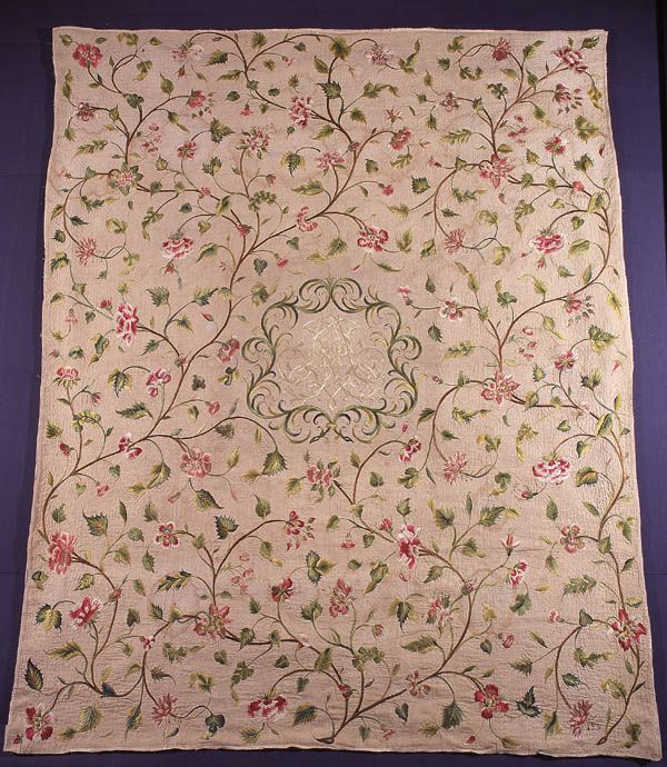 Quilt  English   c. 1700-1725  Bedcover  Embroidery and quilting. Linen and silk.  Flowering branches and a central monogram