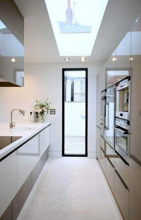 We found numerous long narrow kitchen layout ideas, and there are probably more available online. For more go to thekitchenvibe.com #kitchenlayout #longnarrowkitchen