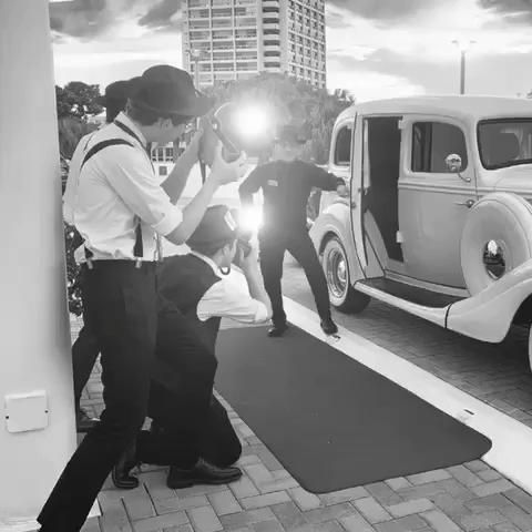 Gatsby Glamour, Old Hollywood Style, as Flash Reporters awaiting the VIP's Exit from their Vintage Car. #oldhollywoodglamour  #oldhollywoodglam  #paparazzi #glamourwedding  #glamourmodels  #hollywoodpartytheme   #hollywoodparty #flashmob  #cameraphotographyideas  #redcarpeteventpartyideas  #redcarpetfashion #vintagecarphotoshoot  #vintagecars #bridalcar #promthemes #getawaycar #GatsbyParty #Gatsbywedding