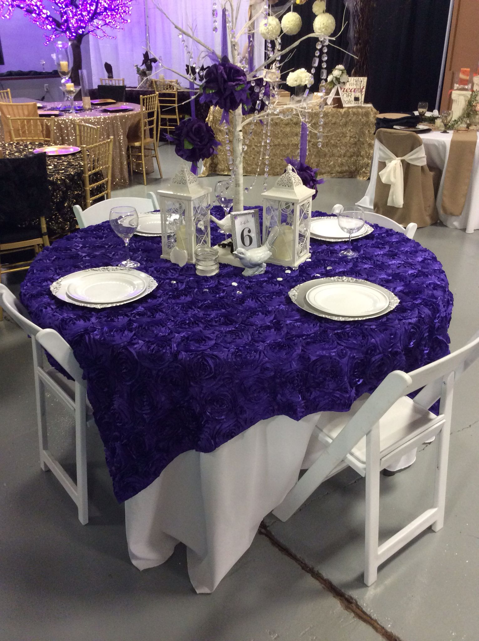 What A Bright And Elegant Look Purple Wedding Color Purple Rosette Overlay Linen Purple And Silver Silv Wedding Rentals Wedding Colors Purple Party Rentals