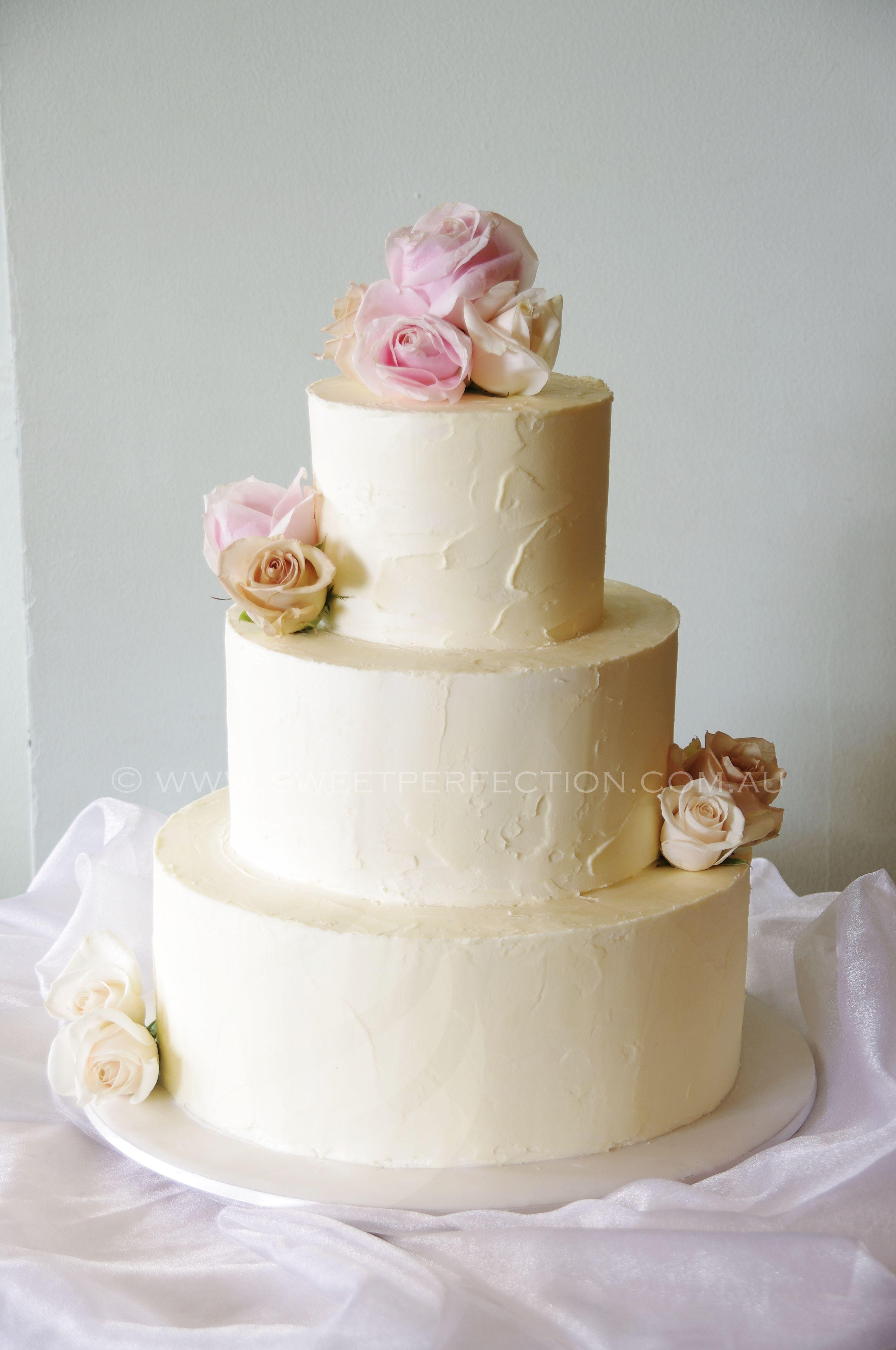 White Chocolate Italian Buttercream Wedding Cake with fresh roses ...