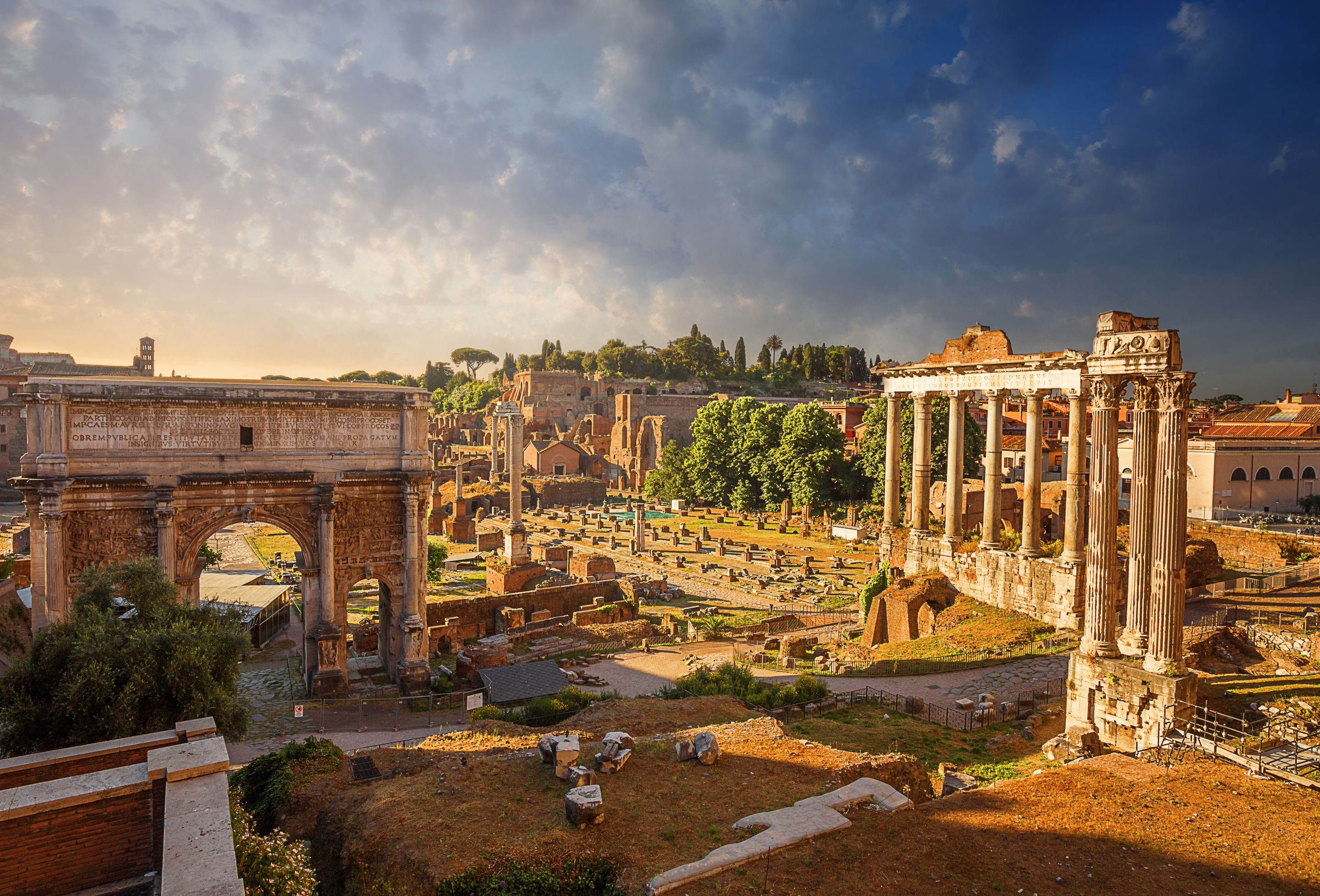 The Ruins Of The Roman Forum Made Up Of Marble Columns