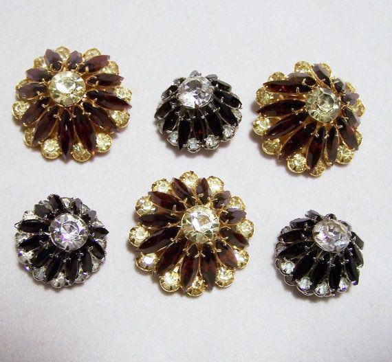 6 Mid Century new old stock rhinestone buttons •3 black and crystal rhinestone 7/8 inch diameter, silver tone setting •3 brown and celery green prong set buttons, 1 1/16 inch diameter, gold tone setting •Vintage sewing supplies •Very good, never worn condition •New old stock, never used •Good vintage condition •International buyers welcome, shipping is automatically combined, overcharges are refunded •Priority shipping upgrades available. Flat rate international is 30$ •32116  • Credit…