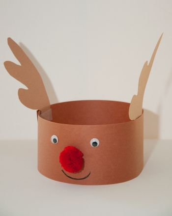 e0a07bce2ccb9 This reindeer hat is cute and festive for your child during the holiday  season. Make a reindeer hat this Christmas with your child.