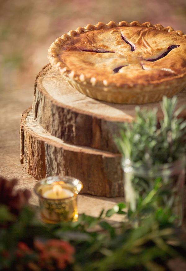 Tree Stump Risers make a simply pretty pie display! *Paisley & Jade vintage & Eclectic Furniture Rentals for Events, Weddings, Theatrical Productions & Photo Shoots*