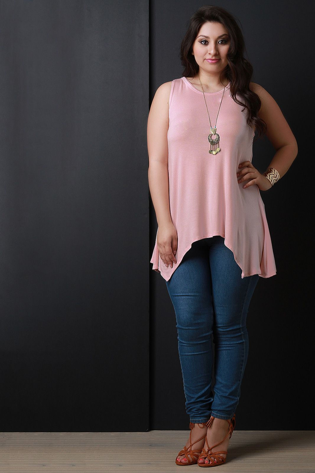 FREE SH & Easy Returns! Shop Sleeveless Sharkbite Tunic Top featuring a plus size tunic top with a soft fabrication, round neckline and an open back with a strappy accent.