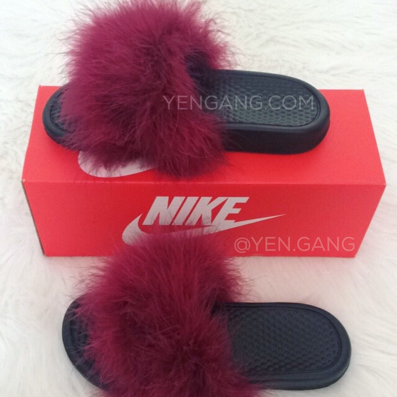 06a0604a847 Image of Fur Nike Slides