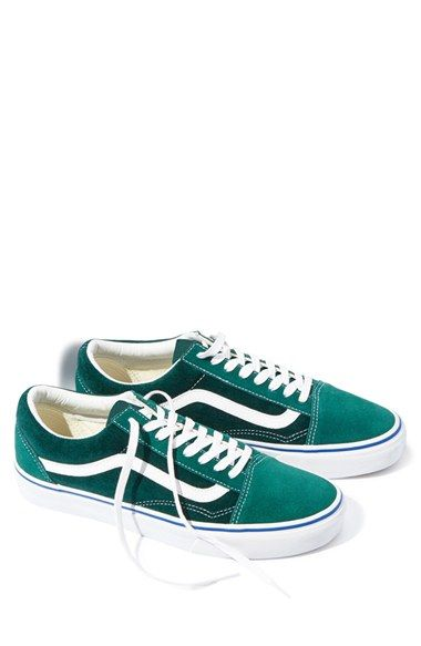 5743d693f8 Throwback branding stamps a sharp street sneaker reinvented in luxe forest- green velvet and set on a bright white ...