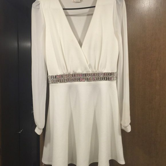 White long sleeve dress White Agaci dress with sheer long sleeves and rhinestone across the middle small stain on sleeve not noticeable a'gaci Dresses Long Sleeve