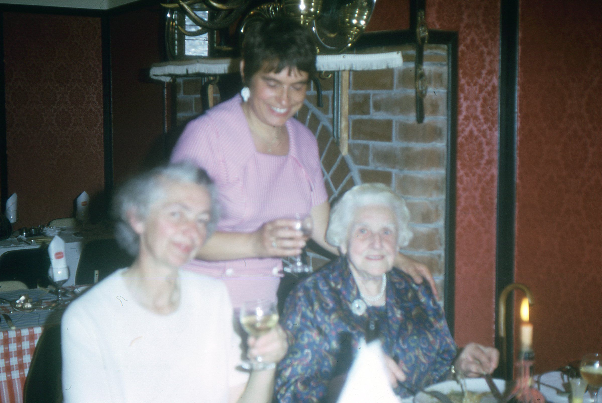 """pic 58. Trip to England with Hubby Derek.  In an Englsh Pub with Derek's sister, Muriel on the left, Hannelies in the middle and """"Mother"""" on the right.  I am sure Derek is behind the camera.  1973.  Her Age: 46"""