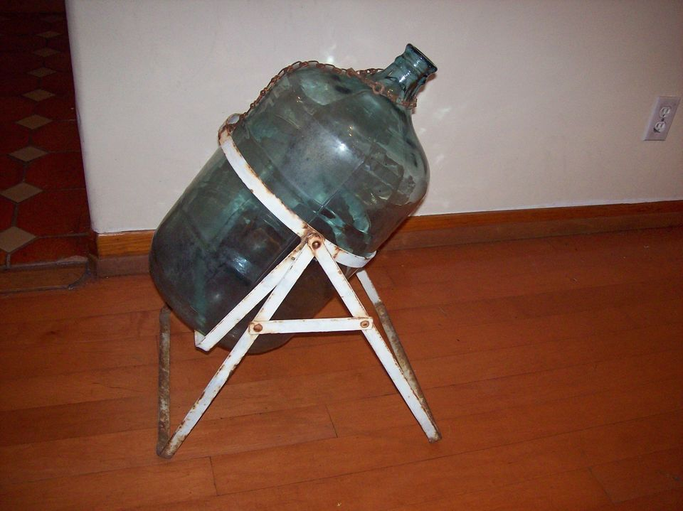 5 gallon clear glass water bottle jug w vintage metal cradle holder