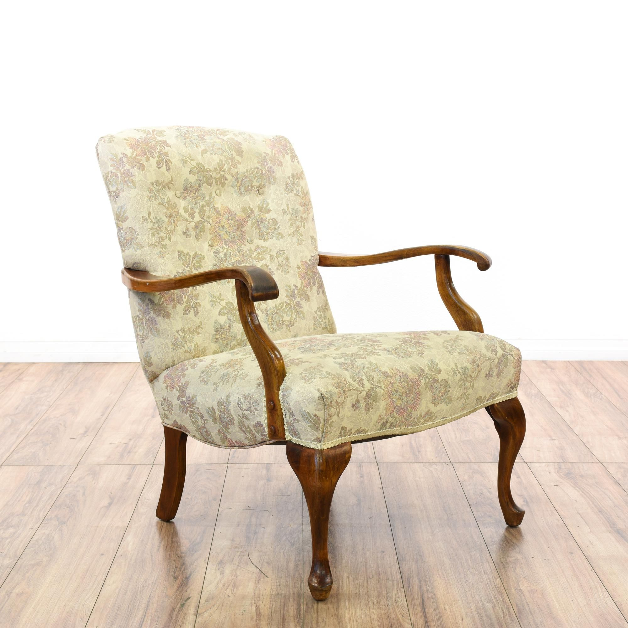This accent chair is upholstered in a durable beige fabric with a