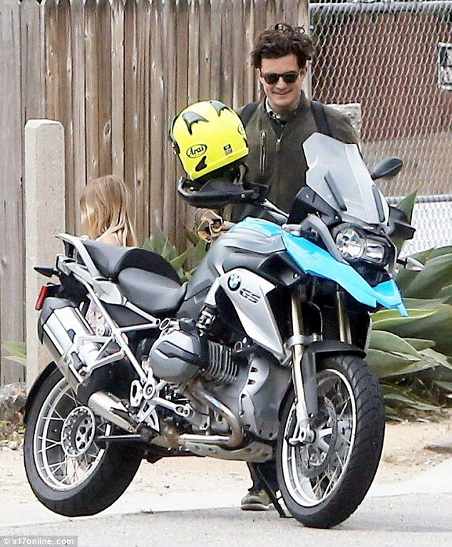 orlando bloom mounts bmw r1200gs motorcycle for a spin in la