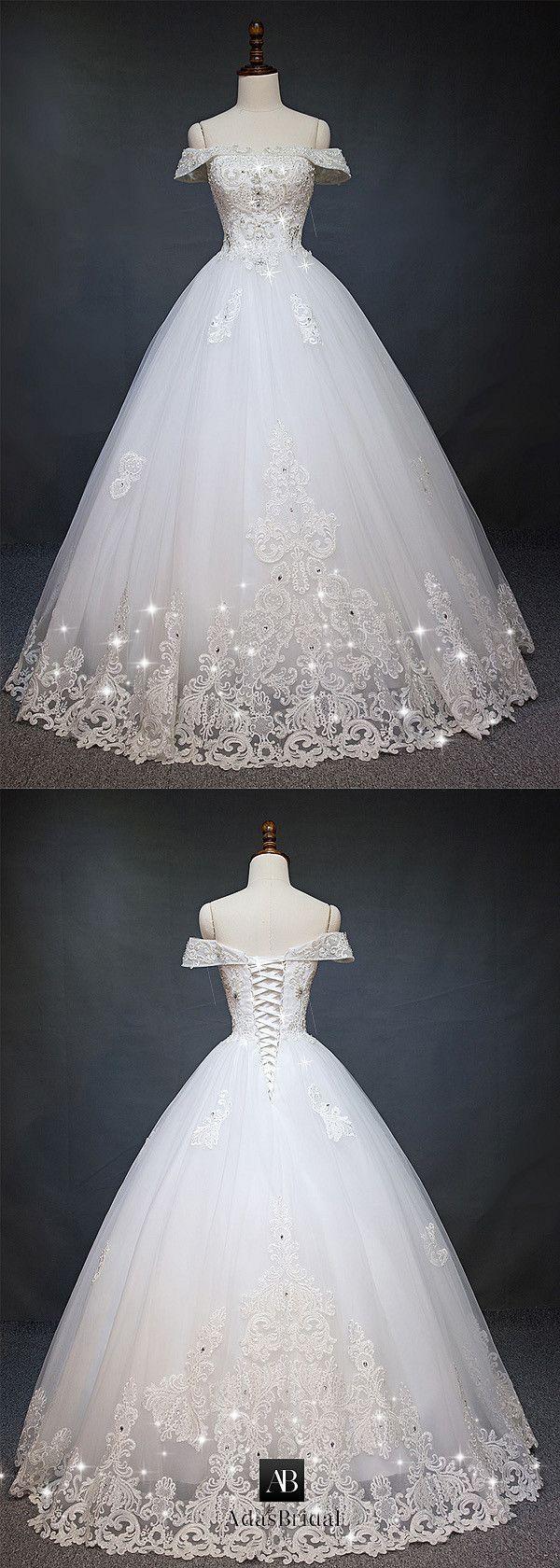 Gorgeous tulle offtheshoulder neckline ball gown wedding dress