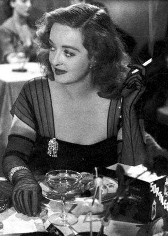 Bette Davies wearing a dress clip