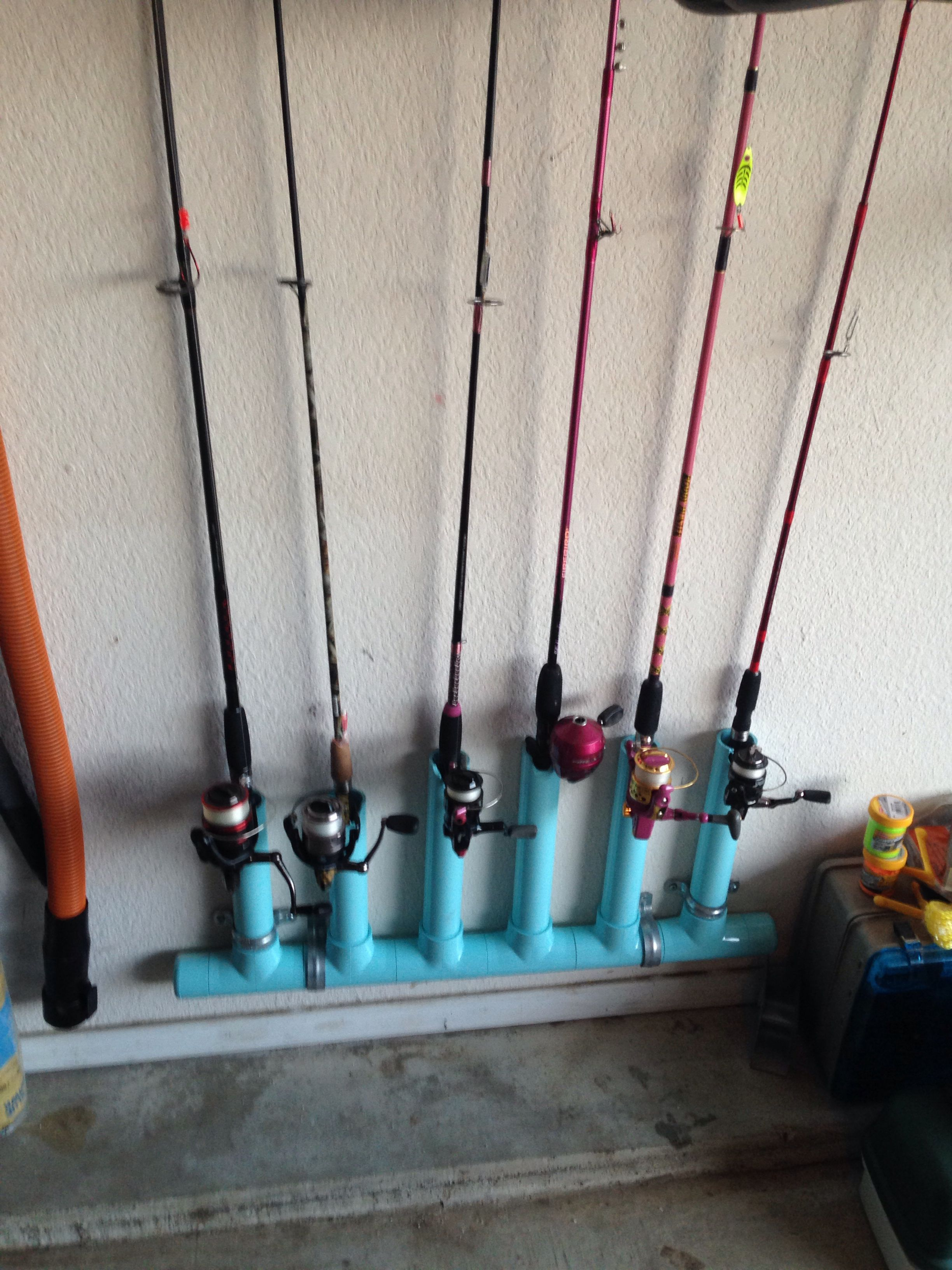 Pvc fishing rod pole holder mounted to the wall and out for Wall fishing rod holder
