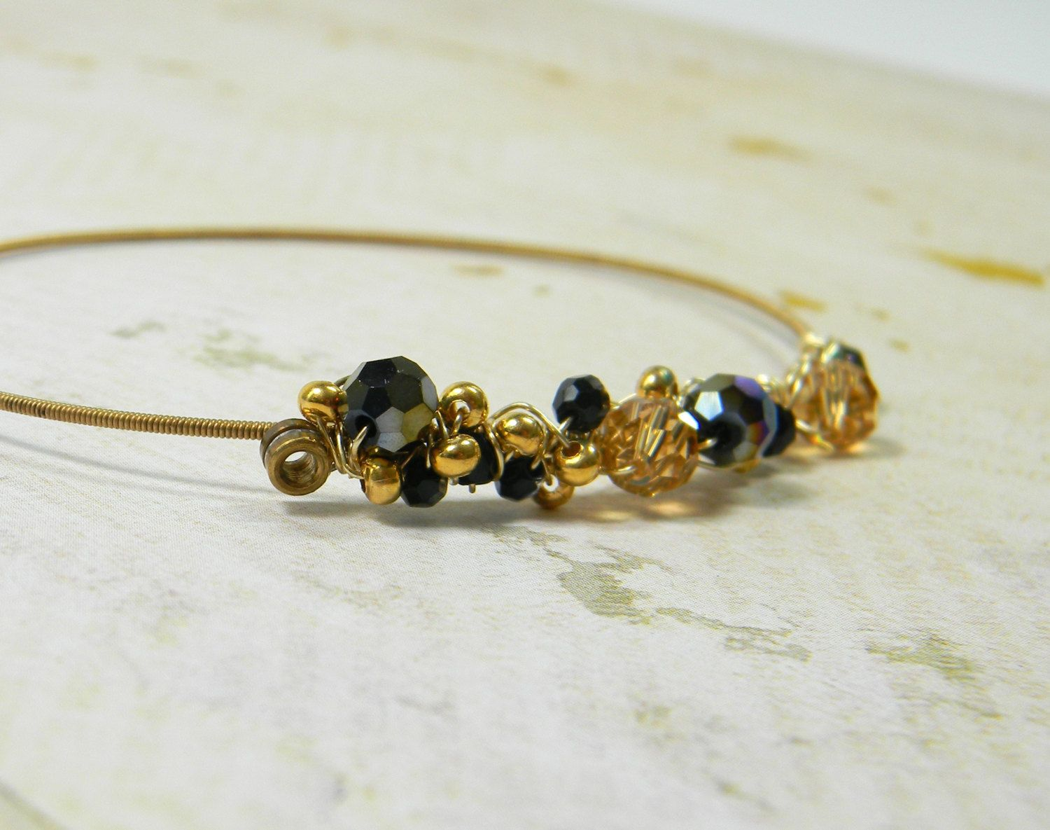 guitar string bangle bracelet, wire wrapped with gold and dark ...