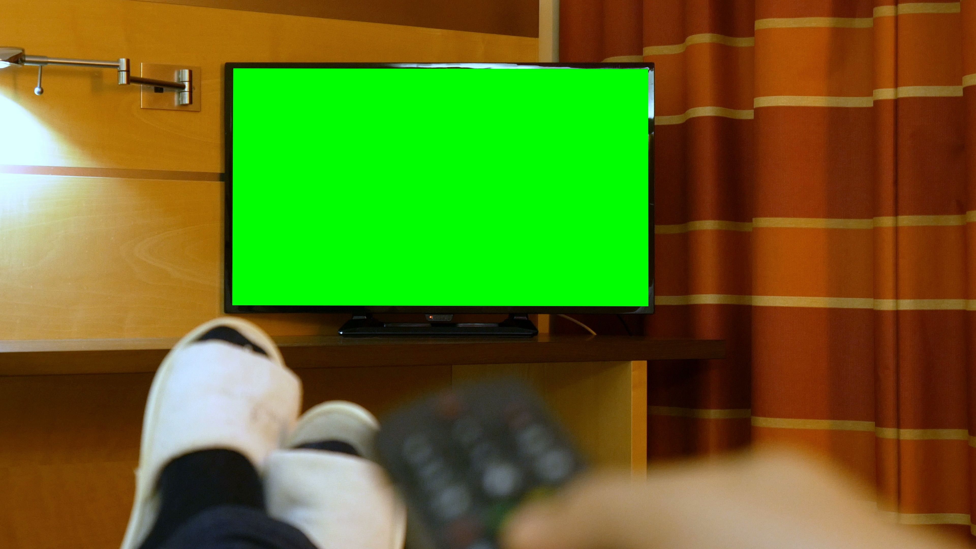 Man Lying Down Bed Relaxing On The Bed Watching Green Screen Tv