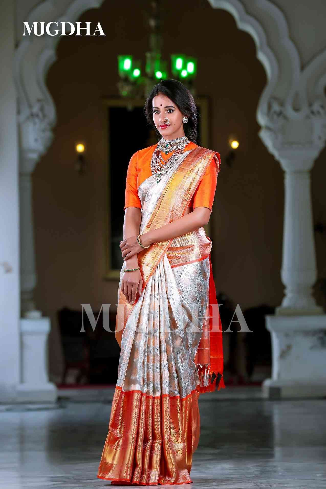 Photo of Traditional White And Orange Color Soft Silk Saree
