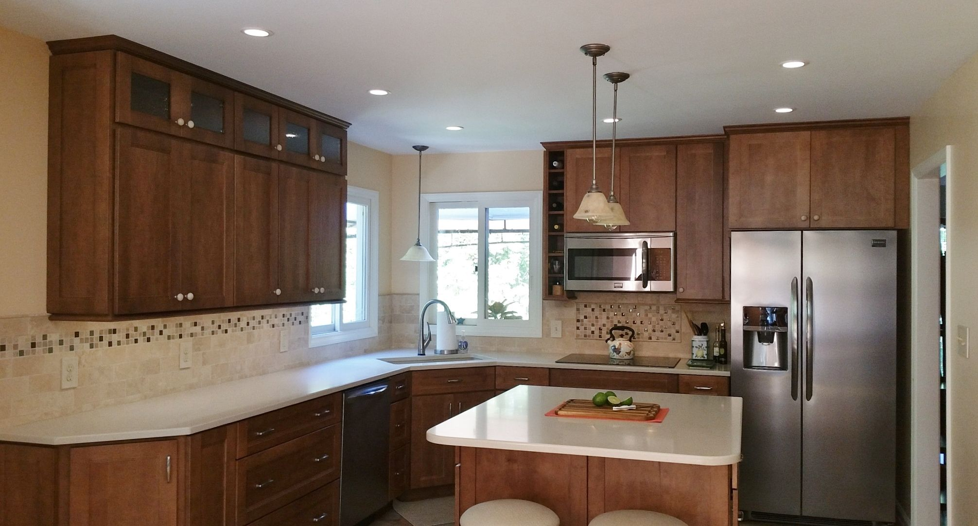 This Small Kitchen Is Packed With Features To Make It More Functional Island With Oven Customized Drawers And Separat Kitchen Design Kitchen Remodel Kitchen