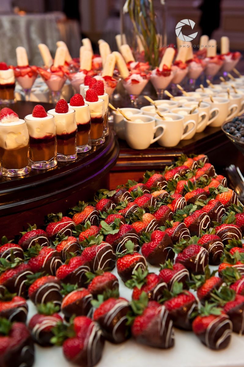 Chocolate covered strawberries and desserts on display ...
