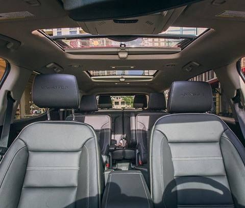The Gmc Acadia Denali Interior Has A Premium Feel Thats Three Rows Deep With An Easy Second Row Pass Through New Car Smell Gmc Acadia Denali