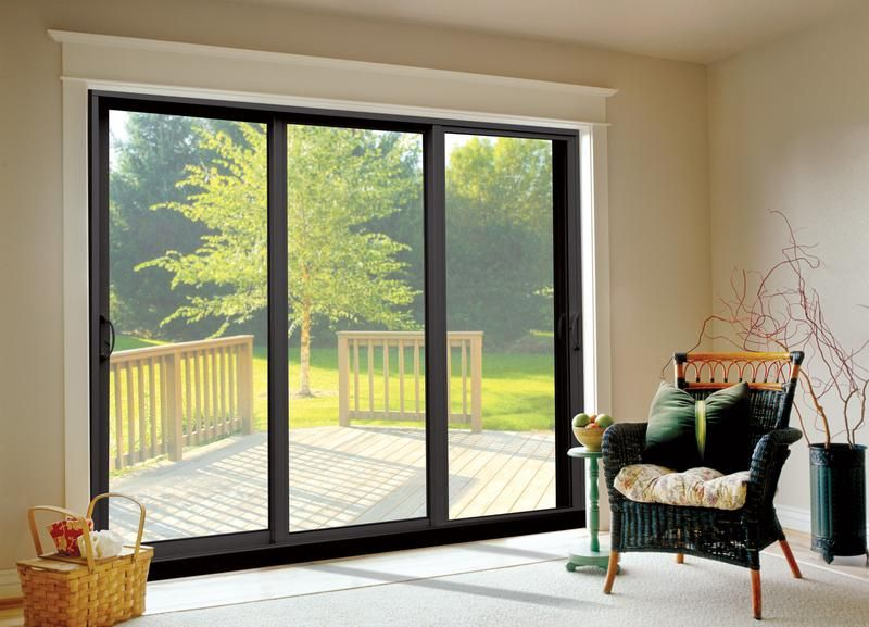 Bronze anodized aluminum sliding patio doors in three for Sliding patio windows