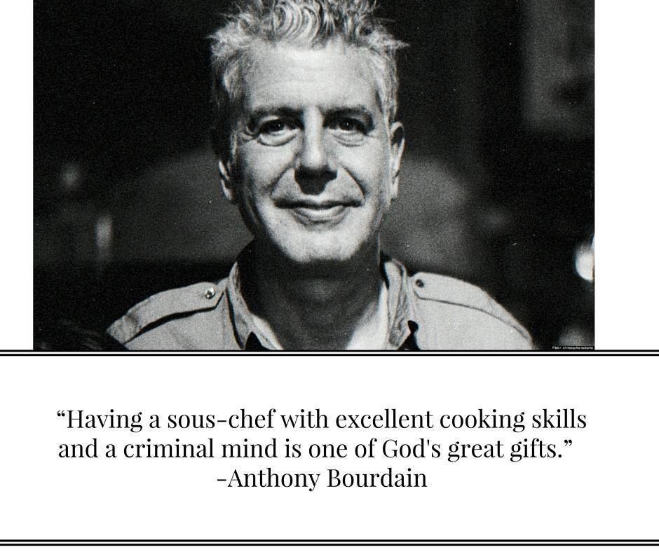 """A photo of Anthony Bourdain with the quote """"Having a sous-chef with excellent cooking skills and a criminal mind is one of God's great gifts."""""""
