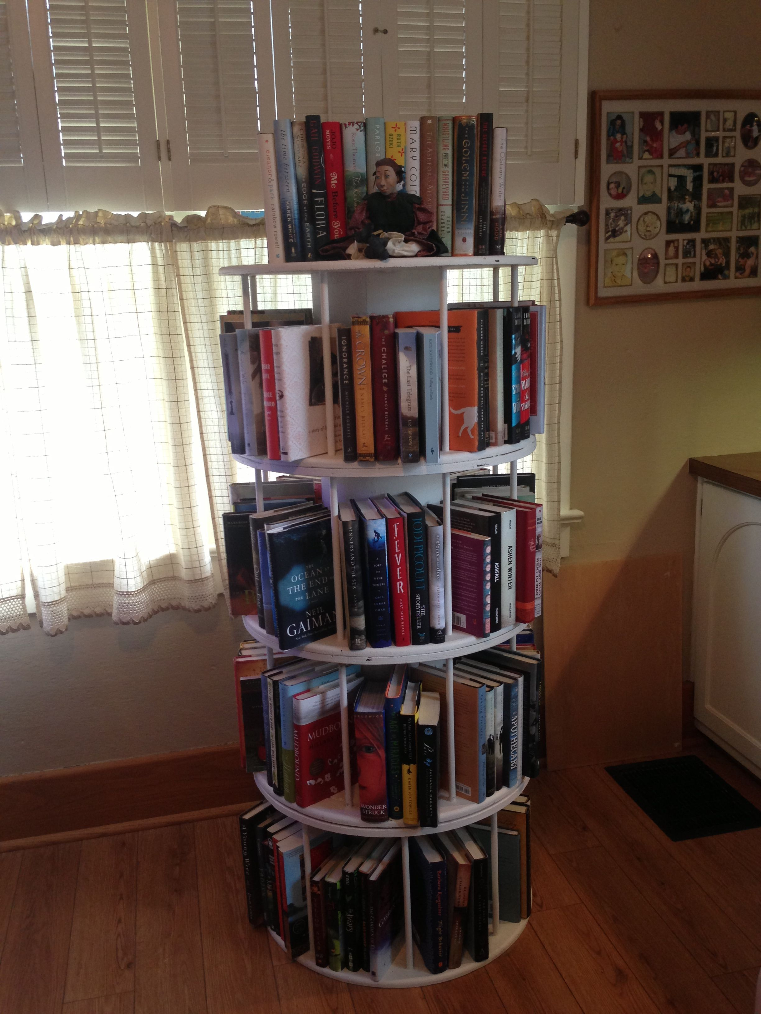 The Rotating Bookshelf My Husband Made From Wire Spools