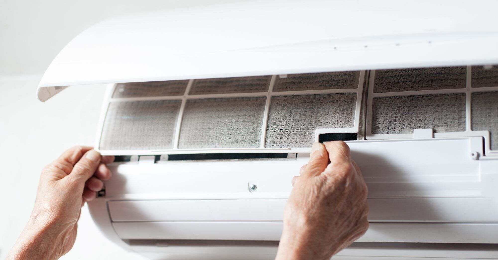 The Exact Right Way to Clean Your Air Conditionerand Why